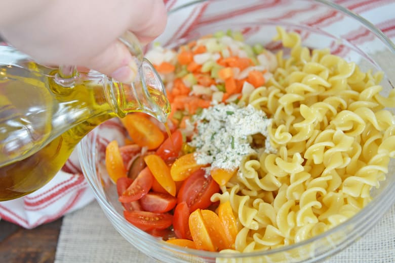 olive oil pouring into ranch pasta salad