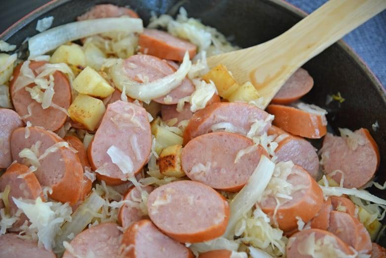 pork and sauerkraut in a skillet