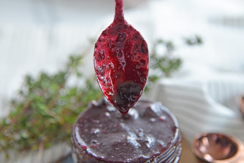 blueberry sauce dripping off a spoon