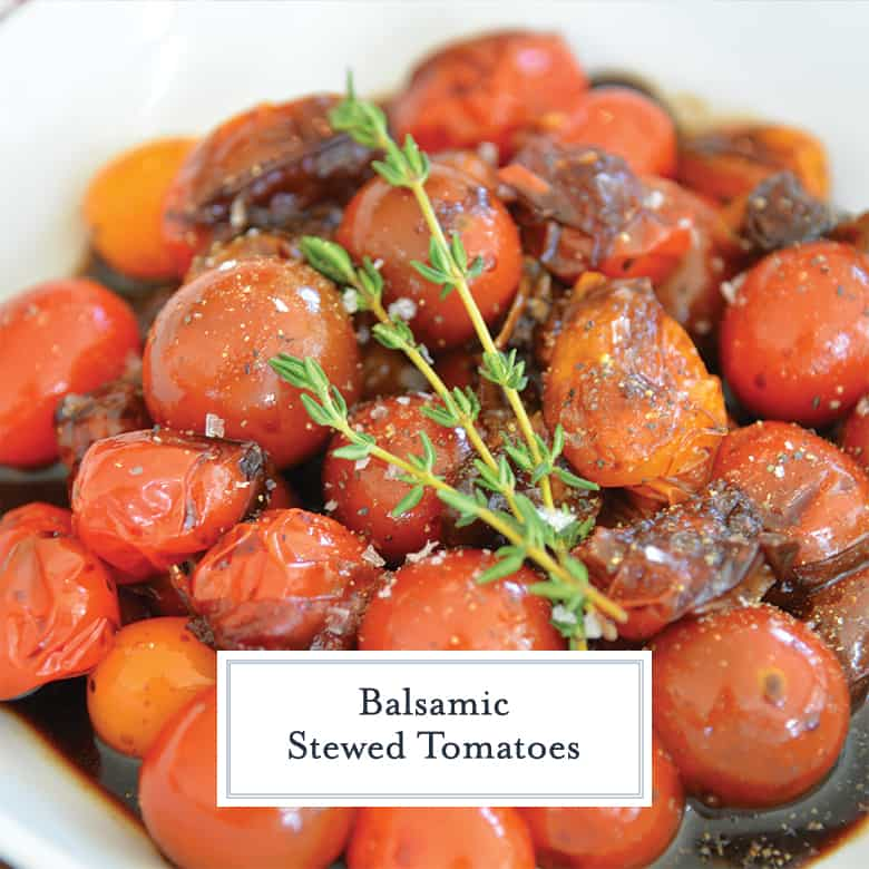 close up of stewed tomatoes with salt, pepper and fresh thyme