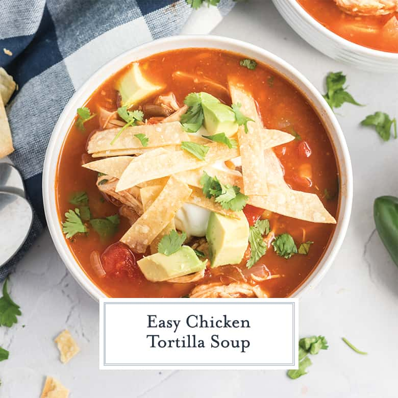overhead bowl of chicken tortilla soup with avocados
