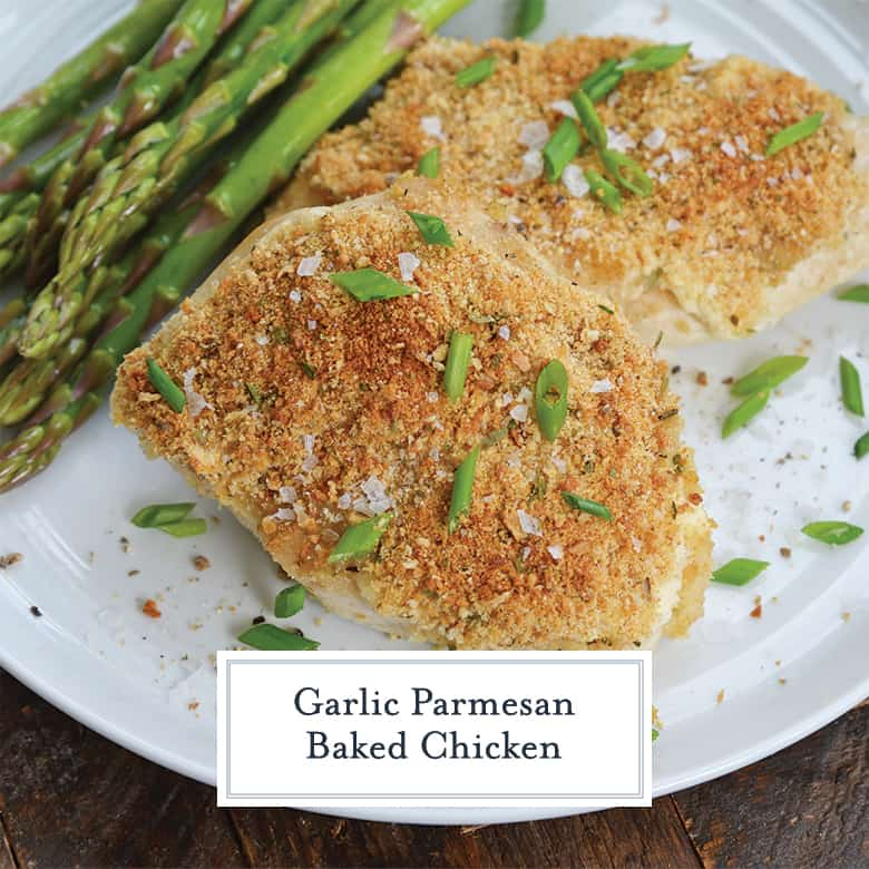 garlic parmesan chicken with chives and asparagus on a white plate