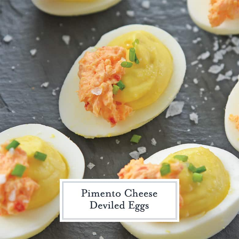 pimento cheese deviled eggs on a slate serving board