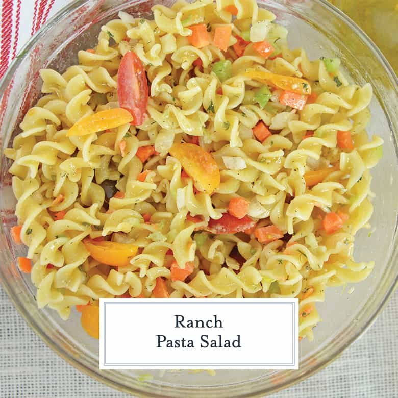 overhead of cold pasta salad with tomatoes