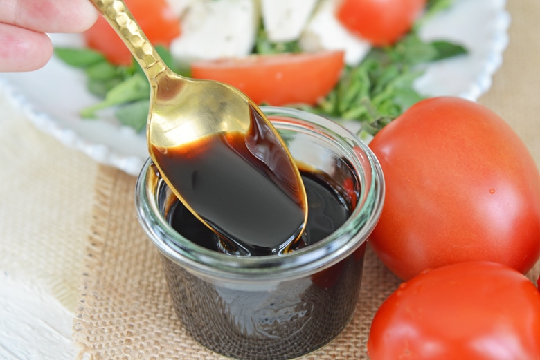 gold spoon with balsamic reduction sauce