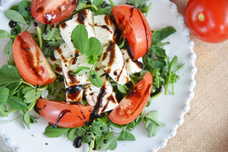 balsamic reduction drizzled on caprese salad