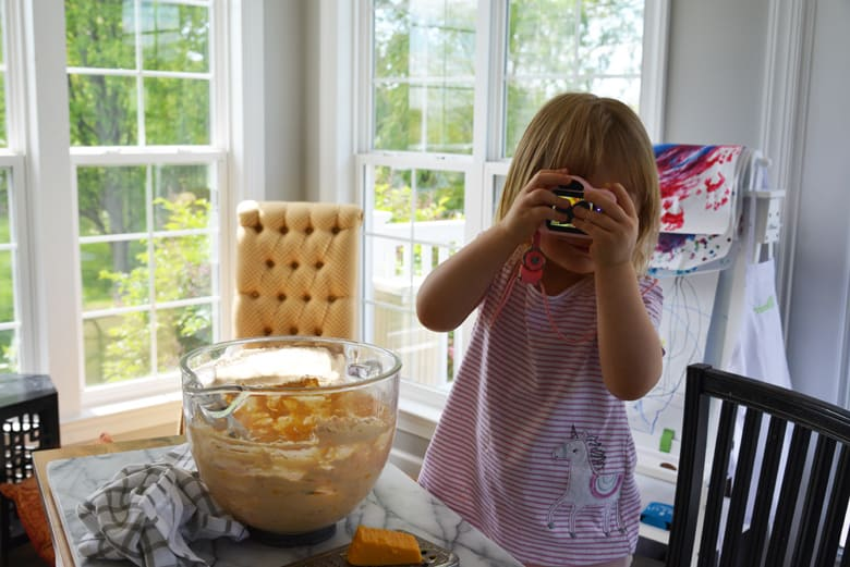 little girl taking a picture