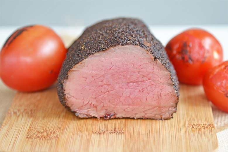 cross sectional view of a beef tenderloin cooked to medium rare
