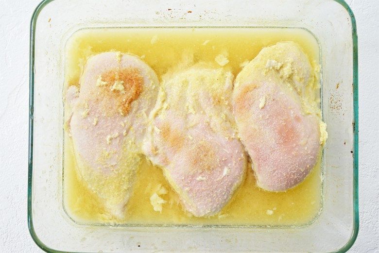 chicken cooked with chicken broth in a baking dish
