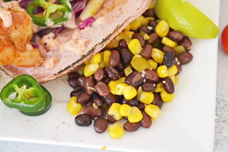 black bean salad served as a side dish to shrimp tacos