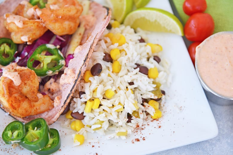 fiesta rice on the side of shrimp tacos