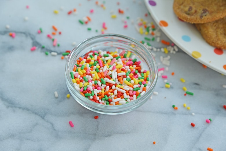 rainbow sprinkles in a clear glass bowl