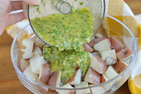 pouring dressing on boiled potatoes