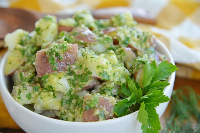 angle view of potato salad dressed with cold herb dressing