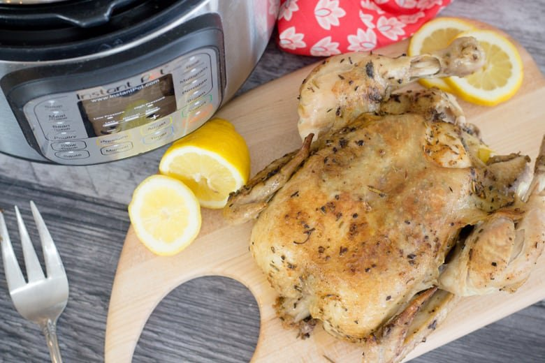 overhead view of whole roasted chicken on cutting board