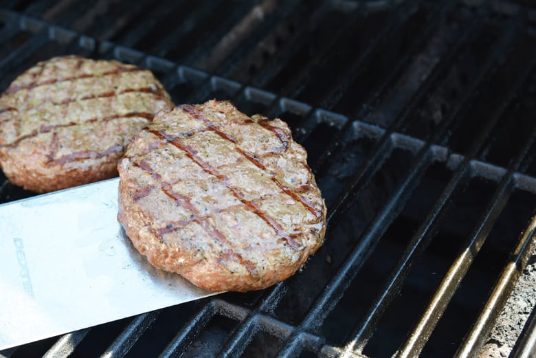 greek burgers on the grill with char marks
