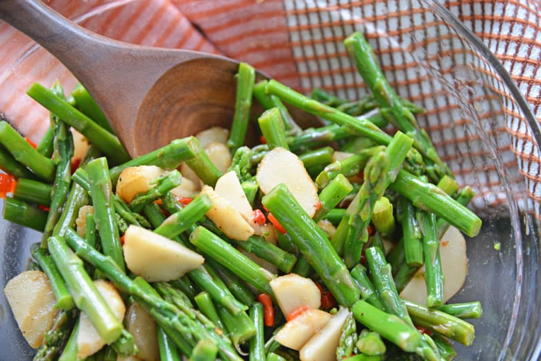 pickled asparagus salad in a mixing bowl