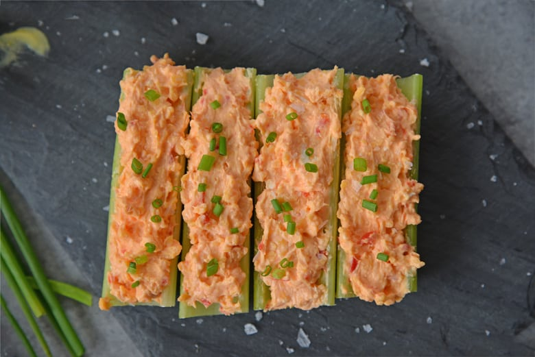 several sticks of celery with pimento cheese