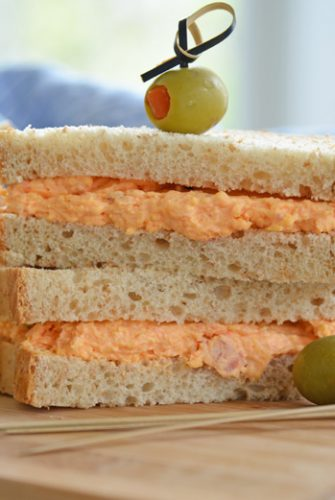 pimento cheese sandwich on wheat bread with olives
