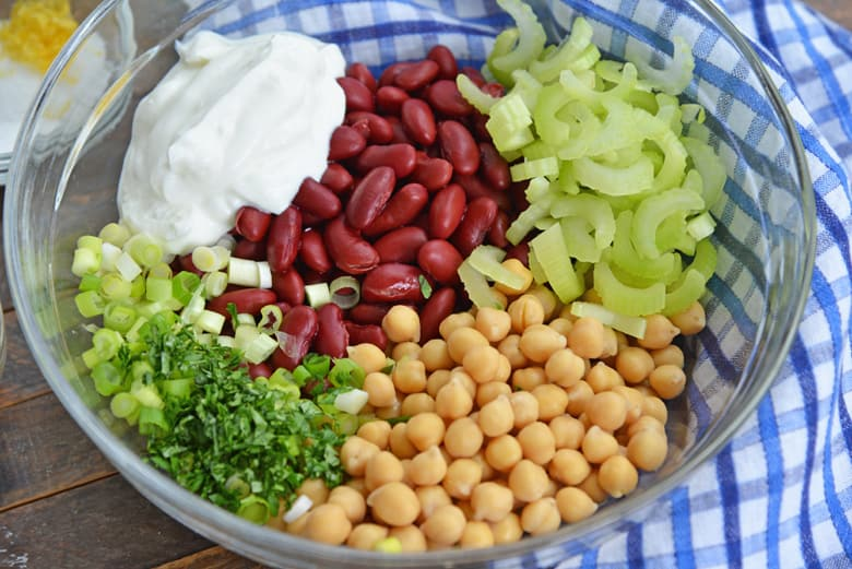 ingredients for red bean salad- red kidney beans, chickpeas, scallions, celery, yogurt, parsley