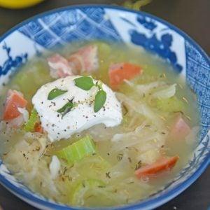 bowl of Sauerkraut Soup with sour cream garnish