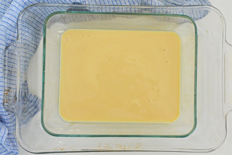 sweetened condensed milk in a baking dish with water bath