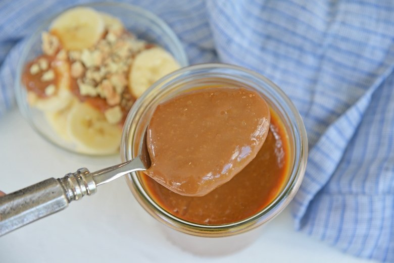 spoon with thick caramel sauce
