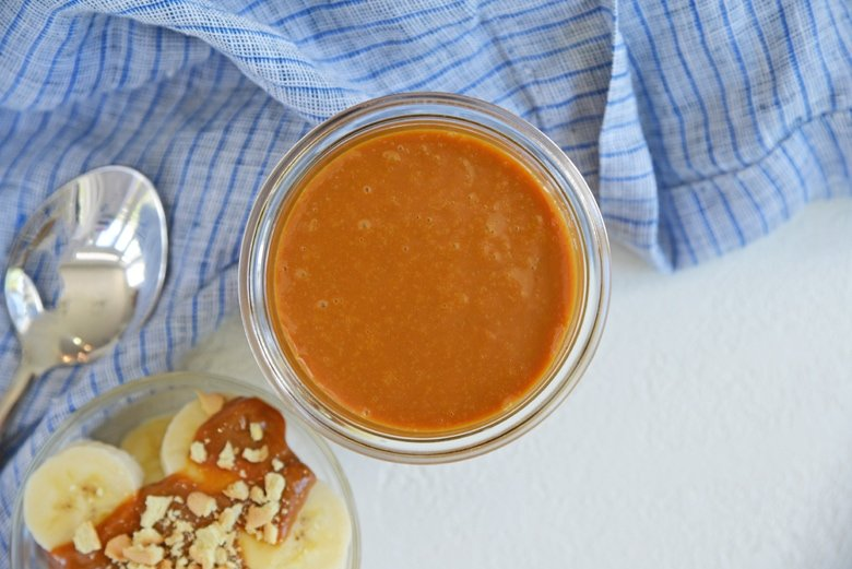 overhead view of homemade sweetened condensed milk caramel in a glass jar