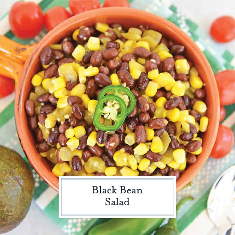 Overhead of black bean and corn salad with jalapenos in orange bowl