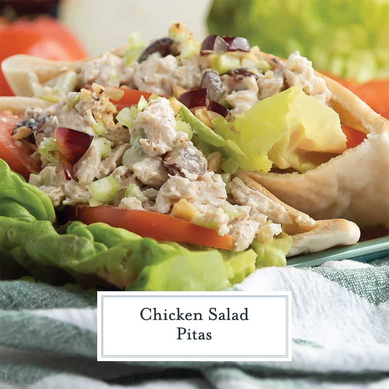 close up of chunky chicken salad with grapes in pita brad