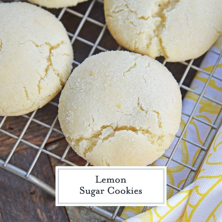 close up of lemon sugar cookie on a cooling rack with yellow linen
