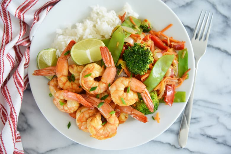overhead of white plate with stir fried shrimp