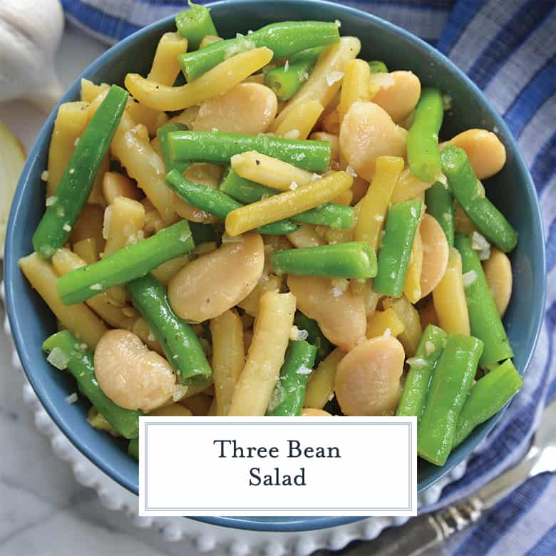 close up of three bean salad in a blue serving bowl