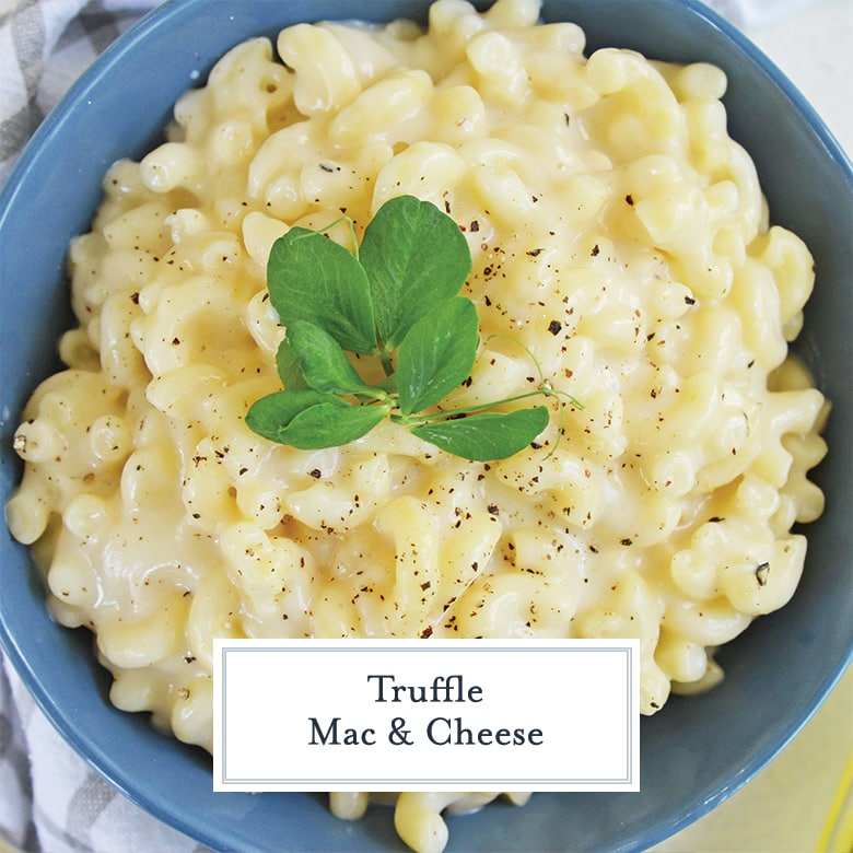 truffle mac and cheese with pea shoots and cracked black pepper in a blue bowl
