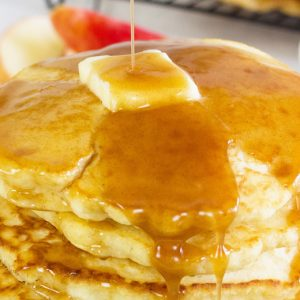 close up of apple cider syrup on pancakes