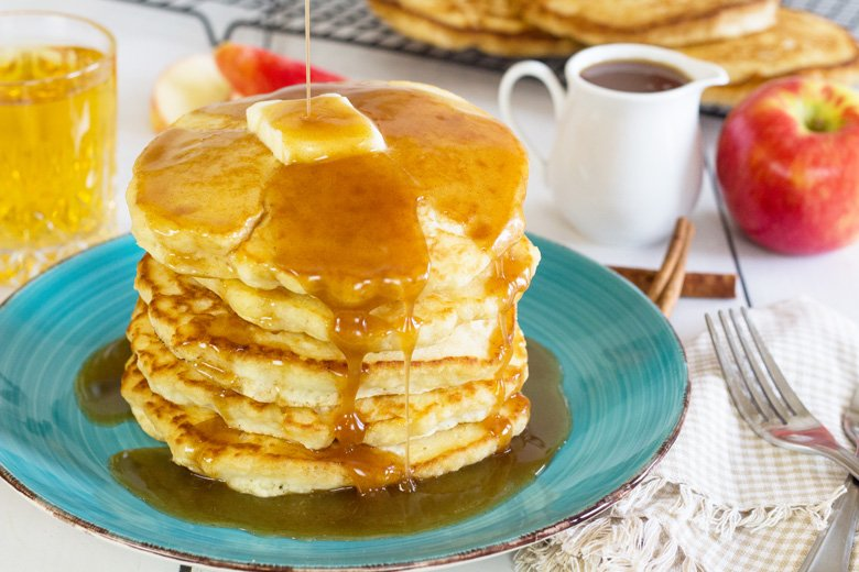 fluffy pancakes with syrup on a breakfast table