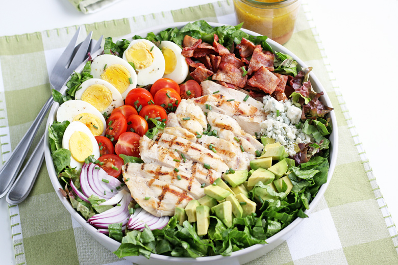 cobb salad on a green placemat