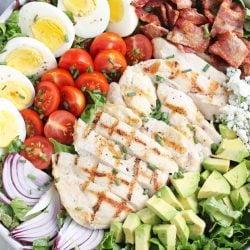 close up of sliced chicken on cobb salad