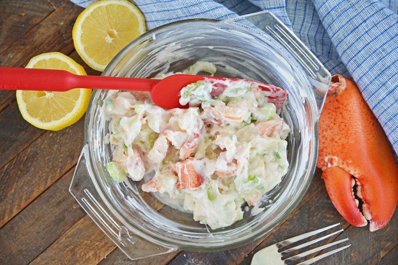 cold lobster salad mixed together in a mixing bowl