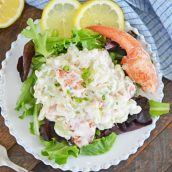 overhead of cold lobster salad on a plate with greens