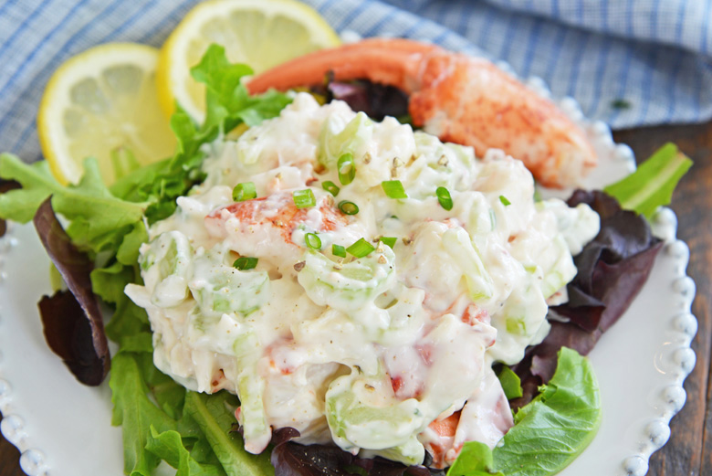 close up of cold lobster salad on greens