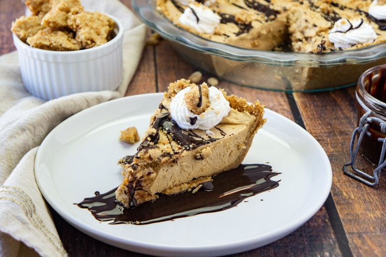 slice of peanut butter pie drizzled with fudge sauce