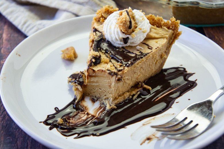 slice of peanut butter pie with whipped cream and fudge sauce