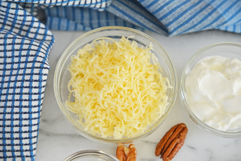 shredded gouda cheese in a small glass bowl