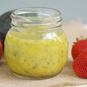 a jar of poppyseed dressing on burlap
