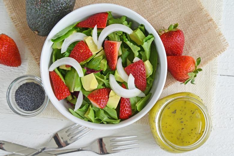 overhead og strawberry salad with dressing