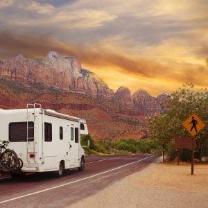 RV driving through a state park