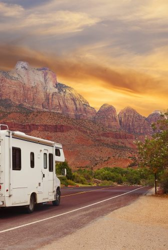 RV driving through a state park