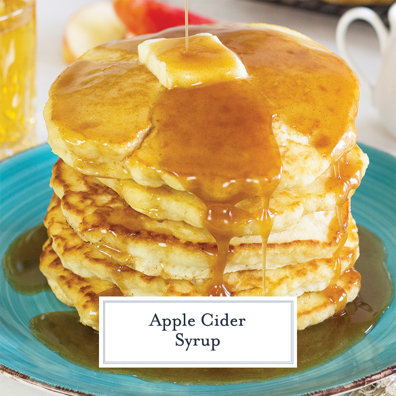 apple cider syrup pouring over a stack of pancakes on a teal plate