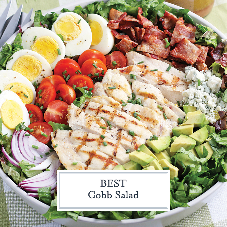 angle view of large cobb salad in a white bowl
